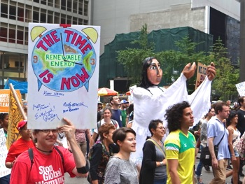 photos of UN climate change marchers signs